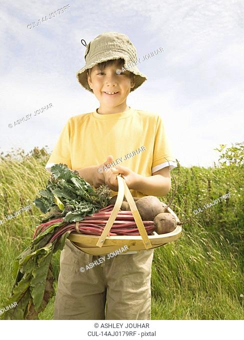 Boy with a scuttle of Beetroots