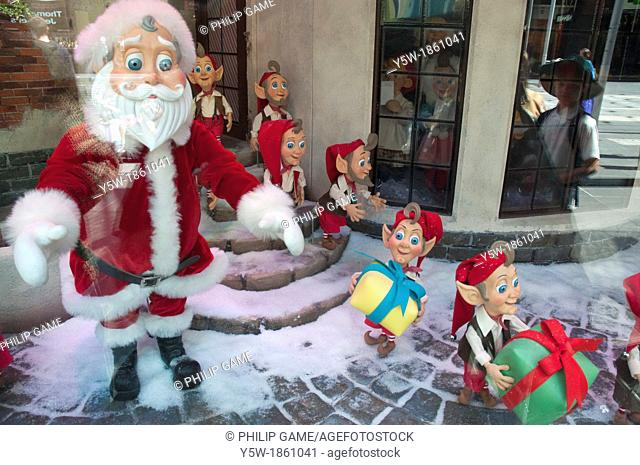 Children are reflected in the Christmas pageant display in the Myer department store windows, Melbourne