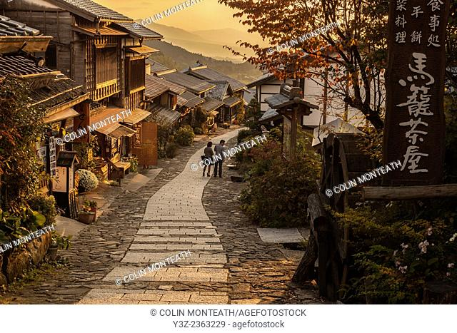 Tourists at end of day's walk between Magome and Tsumago, old post road between Kyoto and Tokyo, Northern Japan Alps, Japan,
