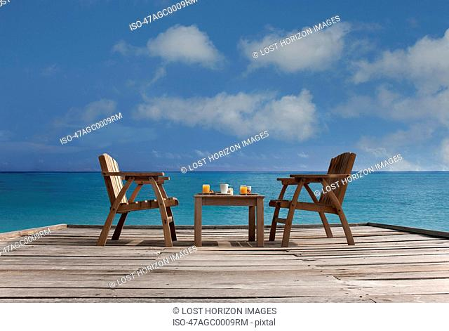 Table and chairs on wooden dock