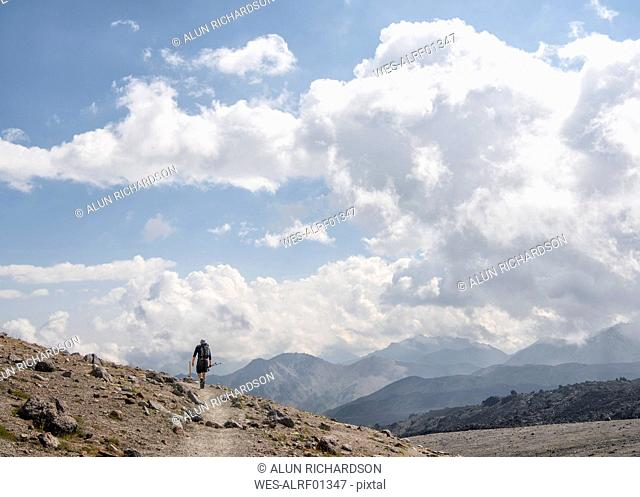 Russia, Caucasus, Mountaineer hiking in Upper Baksan Valley