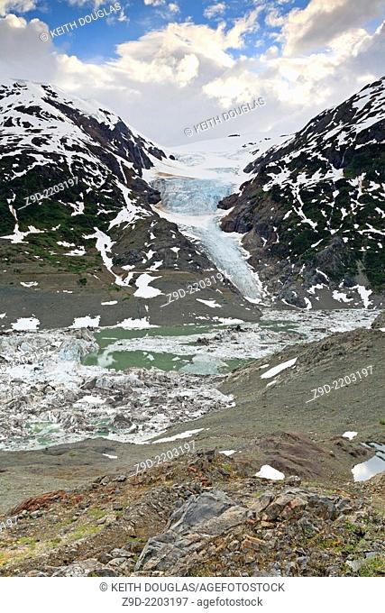View across snout of Salmon Glacier and Summit Lake towards Augus Glacier and Augus Mountain on right. Stewart, British Columbia