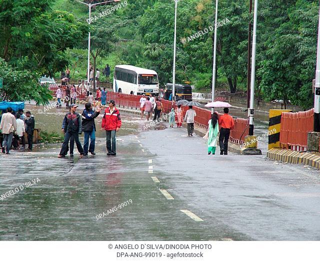 People enjoying the rain while walking