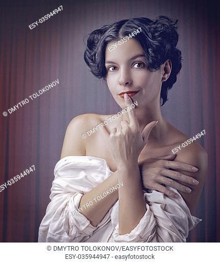 Sensuality. Beauty brunette, retro styled female portrait