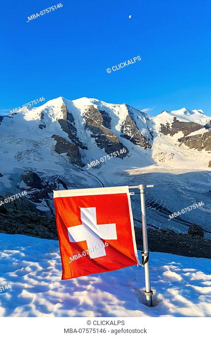 Switzerland flag with Palù Peaks and Vedret Pers Glacier in the background, Diavolezza Refuge, Bernina Pass, Engadin, Graubünden, Switzerland, Europe