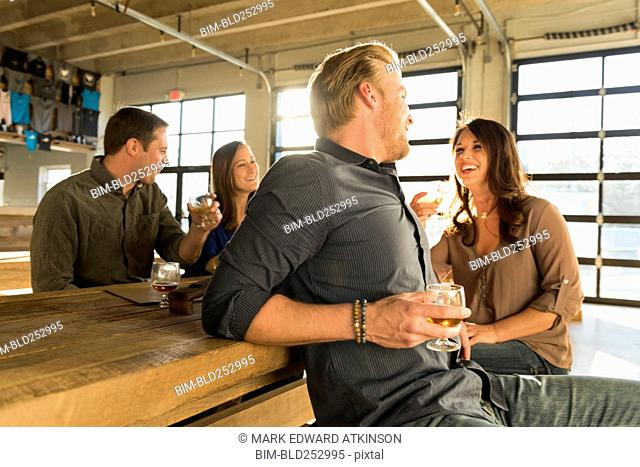 Friends laughing in brew pub