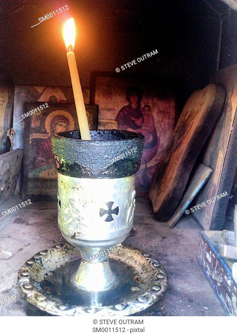 Candle inside a Greek Roadside Shrine, (Eklisaki) Crete, Greece