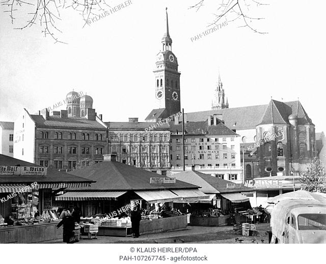 The Viktualienmarkt in Munich in 1954 with the towers of the Frauenkirche in the background on the left, Old Peter in the middle and the tower of the New Town...