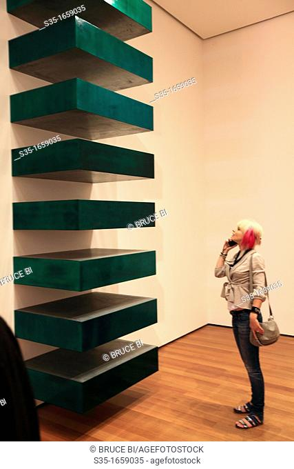 A visitor looking at a art piece in Museum of Modern Art MoMA  Manhattan  New York City  USA