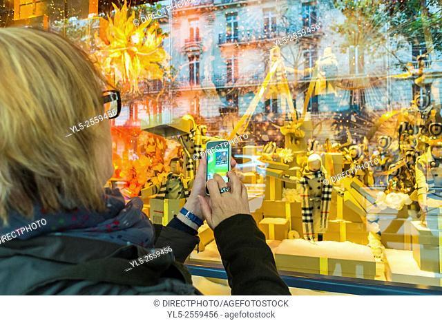 Paris, France, Woman Taking Pictures, Outside, Christmas Shopping, French Department Stores, Printemps, Shop Windows Decor
