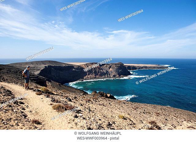 Spain, Canary Islands, Fuerteventura, Jandia, hiker looking to Punta Pesebre