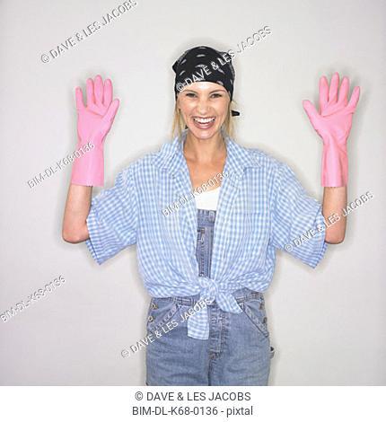 Woman wearing rubber dishwashing gloves