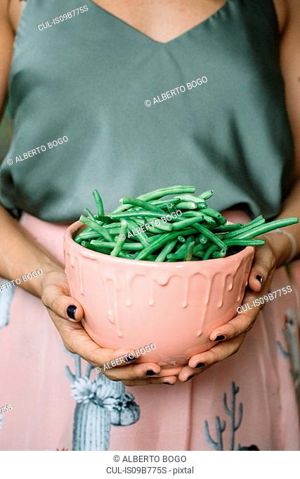 Woman with bowl of beans