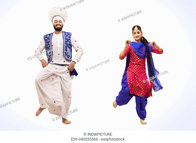 Sikh Couple Doing Bhangra Dance