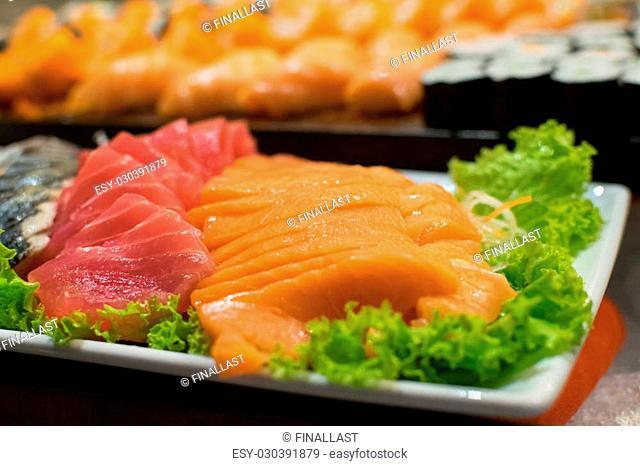 Row of Traditional Japanese sushi and sasimi