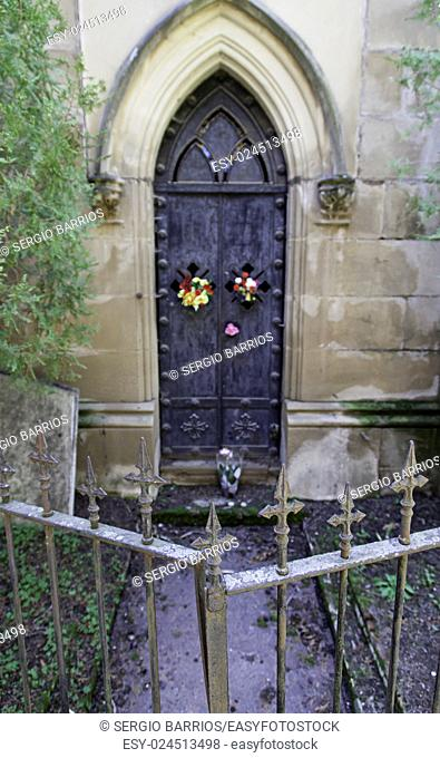 Old gate of a funeral pantheon, detail of edification for dead, graveyard. in Spain