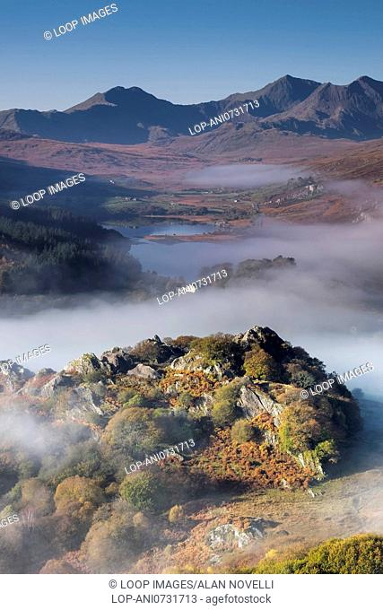 Mist and fog clearing from Llynnau Mymbyr below the Snowdon Horseshoe in Snowdonia