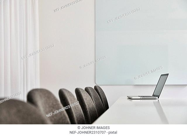 Laptop in empty conference room