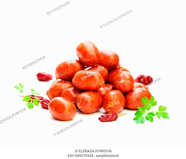 Strings of mini chorizo sausages with hot chili isolated on white