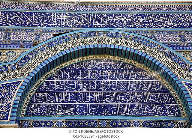 The mosaic exterior of the Dome of the Rock on Temple Mount in the Old City of Jerusalem Closeup of Arabic script on the building