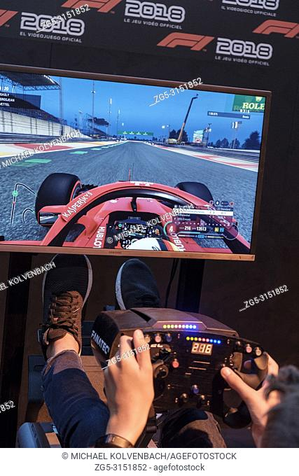 d58f5bce5535 Visitors in the driving simulator F1 2018 at the world s largest fair for  computer and video