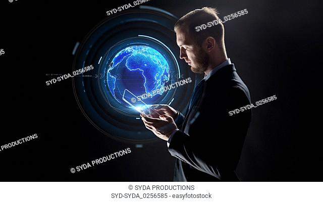 businessman with tablet pc and earth hologram