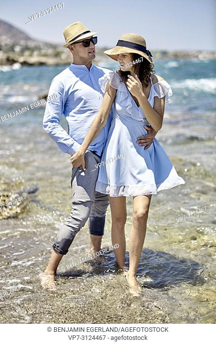 couple at beach in Hersonisssos, Crete, Greece