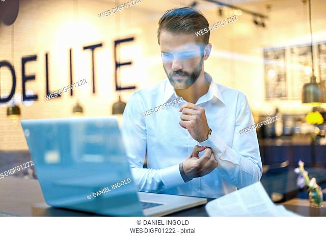 Businessman using laptop in a cafe