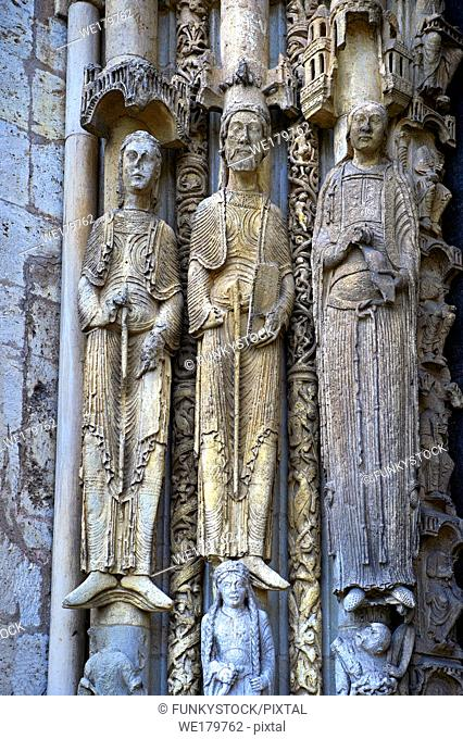 . West Facade, Left Portal c. 1145, Cathedral of Notre Dame, Chartres, France. Gothic statues of three elongated jamb statues are on the left side of the left...