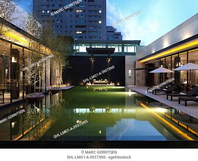 Modern swimming pool at dusk