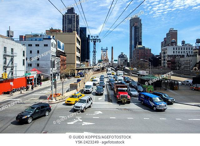 New York, USA. Traffic driving off the Manhattan Bridge, as seen from Roosevelt Island Tram Station on 2nd Avenue, Manhattan