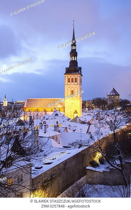 Winter dawn at St Nicholas church in Tallinn old town, Estonia