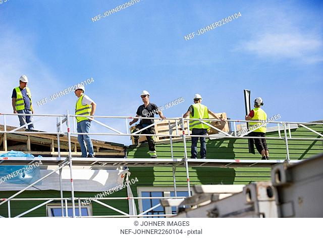 Workers building house