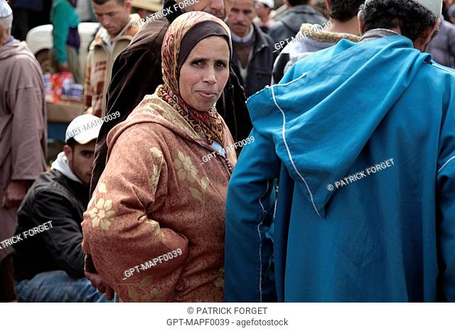 MOROCCAN WOMAN IN THE BERBER MARKET OF TAHANAOUTE, AL HAOUZ, MOROCCO