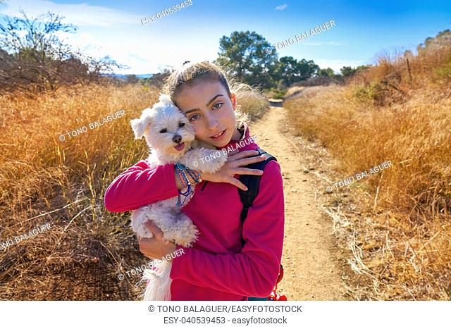 Teen girl hug maltichon in outdoor mediterranean