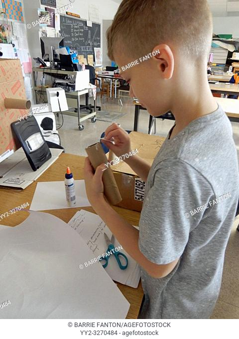 6th Grade Boy Working on Art Project, Wellsville, New York, USA