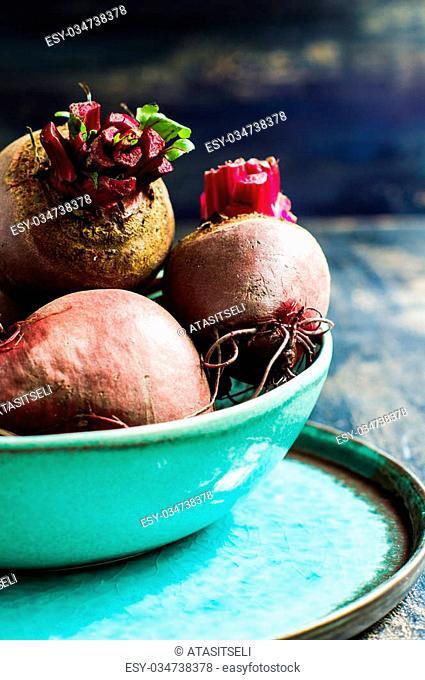 Fresh organic beet vegetable on vintage plate on rustic wooden background