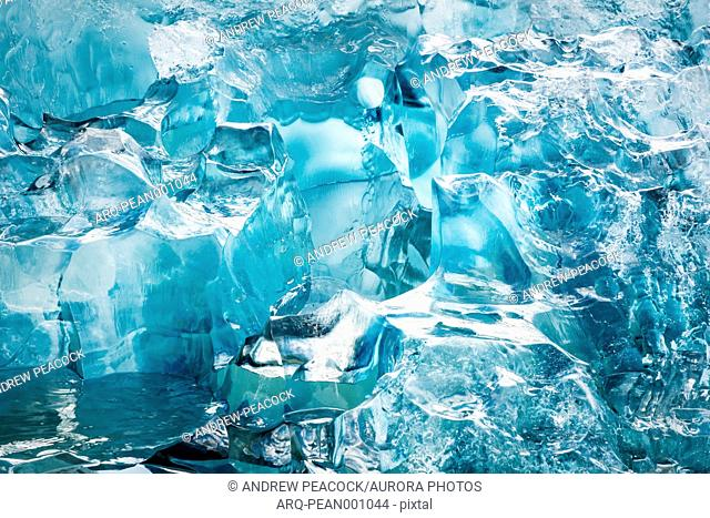 A blue iceberg detail calved from a glacier in Le Conte Bay, southeast Alaska, USA