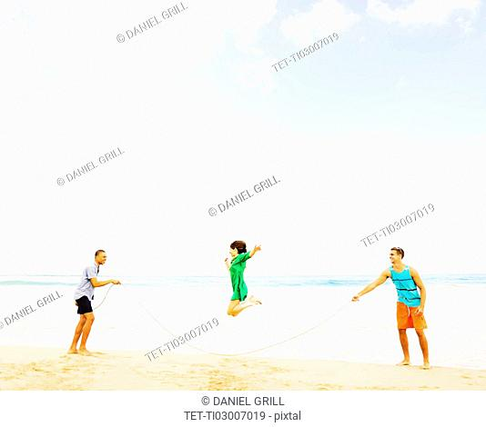 Young people playing on beach