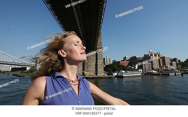 Young woman on a ferryboat, Manhattan, New York, USA