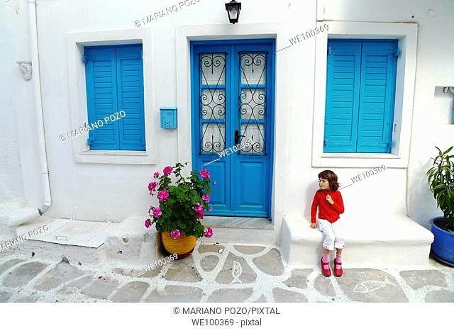 Girl in front of house, Paros, Cyclades islands, Greece