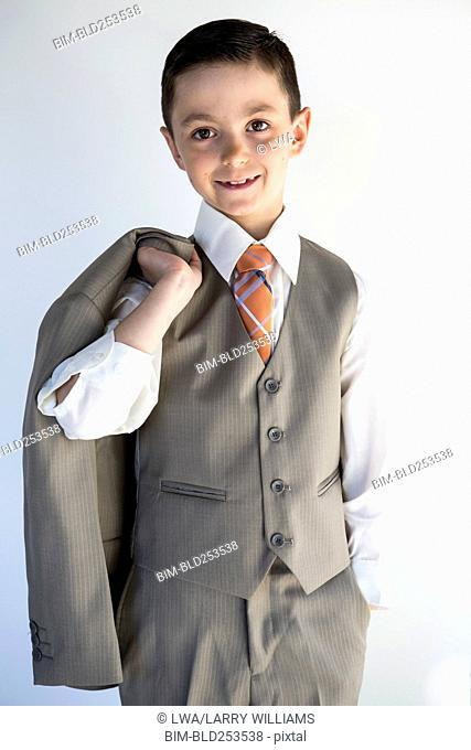 Portrait of smiling boy wearing suit