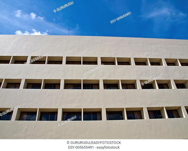Facade windows of office building on blue sky
