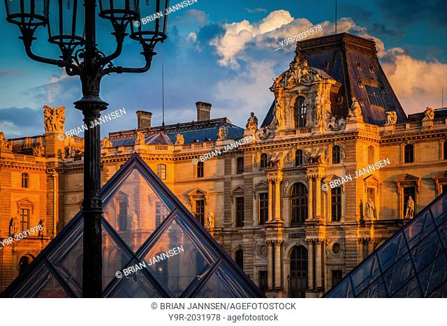 Setting sunlight on the architecture of Musee du Louvre, Paris France