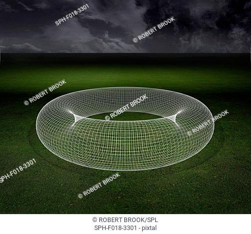 Large torus sitting on grassy plain. Computer artwork
