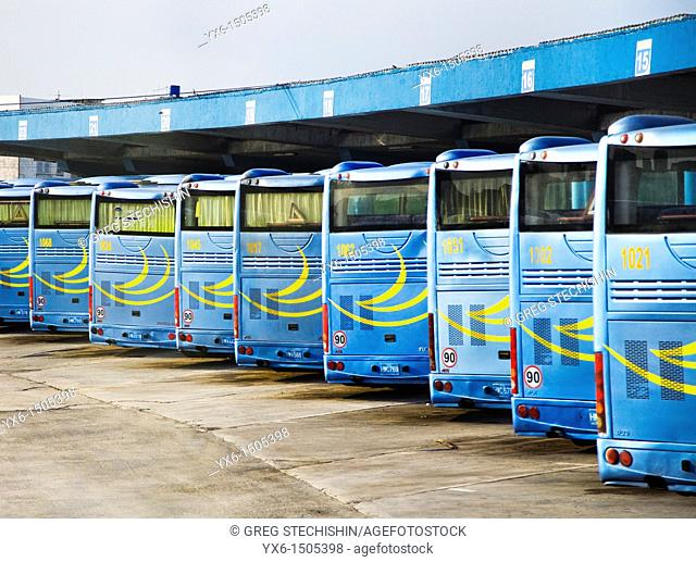 A row of buses at a bus station in Havana, Cuba