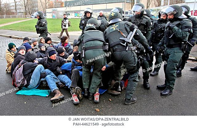 Police officers clear a group of counter demonstrators during an NPDdemo against an emergency asylum seeker's residence in Leipzig, Germany, 07December 2013