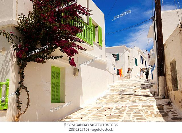 Tourist women walking in the alleys of the Naoussa town Paros, Cyclades Islands, Greek Islands, Greece, Europe