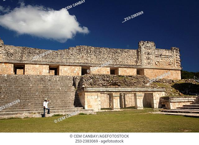 Tourist walking in Uxmal Ruins near the Quadrangle Of The Nuns, Yucatan Province, Mexico, Central America
