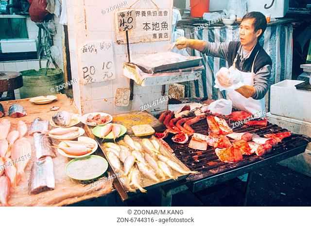 Asian fishmonger or fish seller in Hong Kong wet market